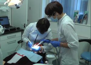 Dentists working on a patient at Blue Light Dental Clinic in North London