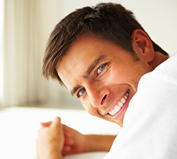 A man smiling after pain free dentistry in london