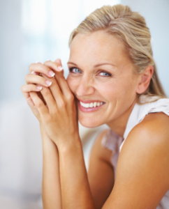 a woman smiling after dermal fillers
